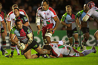 Maurie Fa'asavalu of Harlequins offloads as he is tackled during the Heineken Cup match between Harlequins and Biarritz Olympique Pays Basque at the Twickenham Stoop on Saturday 13th October 2012 (Photo by Rob Munro)