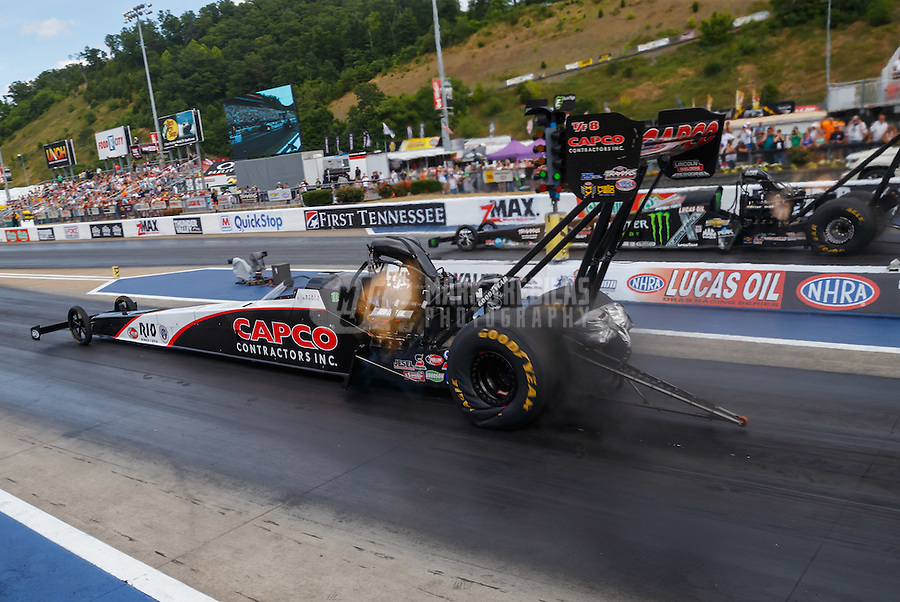 Jun 18, 2016; Bristol, TN, USA; NHRA top fuel driver Steve Torrence (near) races alongside Brittany Force during qualifying for the Thunder Valley Nationals at Bristol Dragway. Mandatory Credit: Mark J. Rebilas-USA TODAY Sports