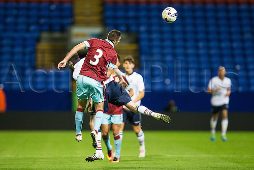 26.07.2016. Macron Stadium, Bolton, England. Pre Season Football Friendly. Bolton Wanderers versus Burnley. Burnley FC defender Daniel Lafferty wins the header