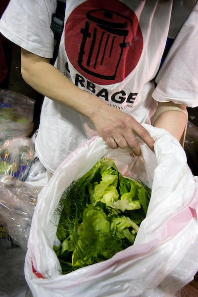 Janet displays fresh lettuce found in the trash outside D'Agnostino's.