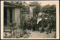 BNPS.co.uk (01202 558833)<br /> Pic: Warwick&Warwick/BNPS<br /> <br /> A funeral of a French solider in Colditz.<br /> <br /> A remarkable archive of photos which provide a glimpse inside the infamous Colditz Castle has come to light.<br /> <br /> The photos show the ingenuity of the Allied POWs who devised ever-bolder ways to escape from the German stronghold during World War Two.<br /> <br /> One image is of a dummy they would hold up to trick the German guards into believing the escaper was still with them during parade head counts. Others reveal the tunnels which were dug using tools smuggled into the 11th century castle in care parcels.<br /> <br /> The photos were taken by the official Colditz photographer Johannes Lange, who was employed by the German Army to take pictures of failed Allied escape attempts. They were then distributed to other POW camps to alert the guards to the methods the inmates were using in their bids for freedom.<br /> <br /> The archive is being sold by a private collector with auctioneer Warwick & Warwick, with an estimate of £1,750.