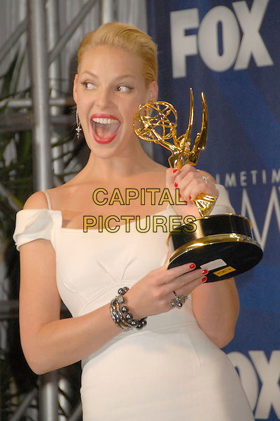 KATHERINE HEIGL (winner for Best Supporting Actress in a Drama Series for Grey's Anatomy).Press room at the 59th Annual Primetime Emmy Awards held at the Shrine Auditorium, Los Angeles, California, USA..September 16th, 2007.half length award trophy white dress nail varnish polish off the shoulder mouth open ring bracelet .CAP/ADM/BP.©Byron Purvis/AdMedia/Capital Pictures.