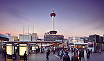 Kyoto Station busy with people in the evening with Kyoto tower and Kyoto tower hotel beautiful sunset city scenery in Shimogyo-ku, Kyoto, Japan 2017.