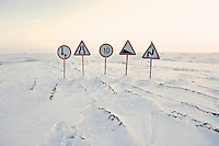 A group of roadsigns on an ice-road built to serve gas and oil companies exploring in the Nenets Autonomous Region in the Russian Arctic. In the summer the road will melt away revealing the marshland that lies beneath. /Felix Features