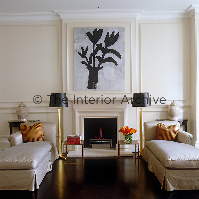 The Donald Baechler painting is the focal point of the elegant symmetry of the drawing room with two facing chaise longues and matching standard lamps