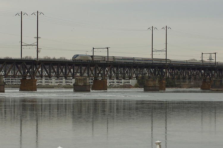 A Amtrak train train crosses the historic bridge over the Susquehanna River at Havre de Grace, Maryland on January 17, 2009...