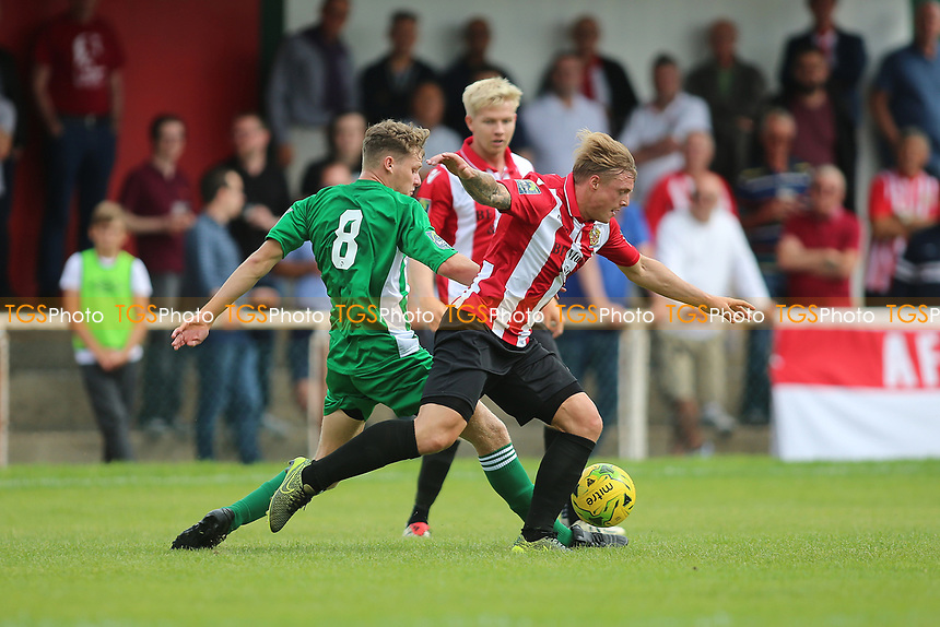 George Purcell of Hornchurch evades Lewis Clayton of Soham during AFC Hornchurch vs Soham Town Rangers, Bostik League Division 1 North Football at Hornchurch Stadium on 12th August 2017