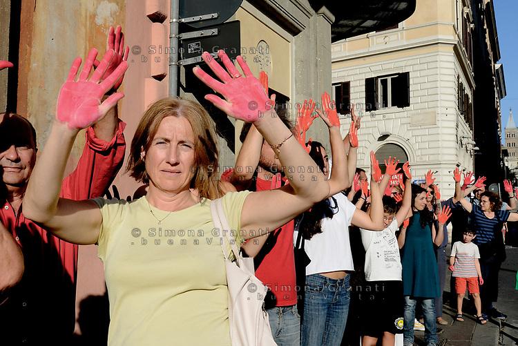 Roma, 23 Luglio 2018<br /> Decine di persone con le mani tinte di rosso a simboleggiare il sangue dei migranti morti in mare, protestano nei pressi del Viminale contro le politiche sull'immigrazione del Governo e del Ministro Salvini