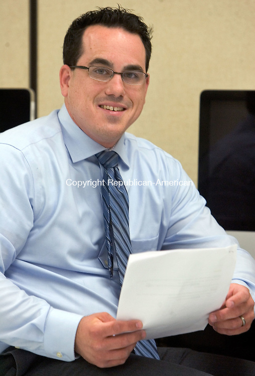 SOUTHBURY CT. 01 June 2015-060115SV07-Brian Jehning sits in a classroom at Pomperaug High School in Southbury Monday.  Jehning a teacher at the school is Region 15's Teacher of the Year. <br /> Steven Valenti Republican-American