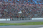 Fans watch the action during the DXC Technology 600 race at Texas Motor Speedway in Fort Worth,Texas.