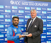 ICC World T20 Qualifier - GROUP B MATCH - AFGHANISTAN v UAE at Grange CC, Edinburgh - Afghanistan bat Mohammad Shazad is awarded Man of the Match by Bob McFarlane, Cricket Scotland Board member — credit @ICC/Donald MacLeod - 10.07.15 - 07702 319 738 -clanmacleod@btinternet.com - www.donald-macleod.com