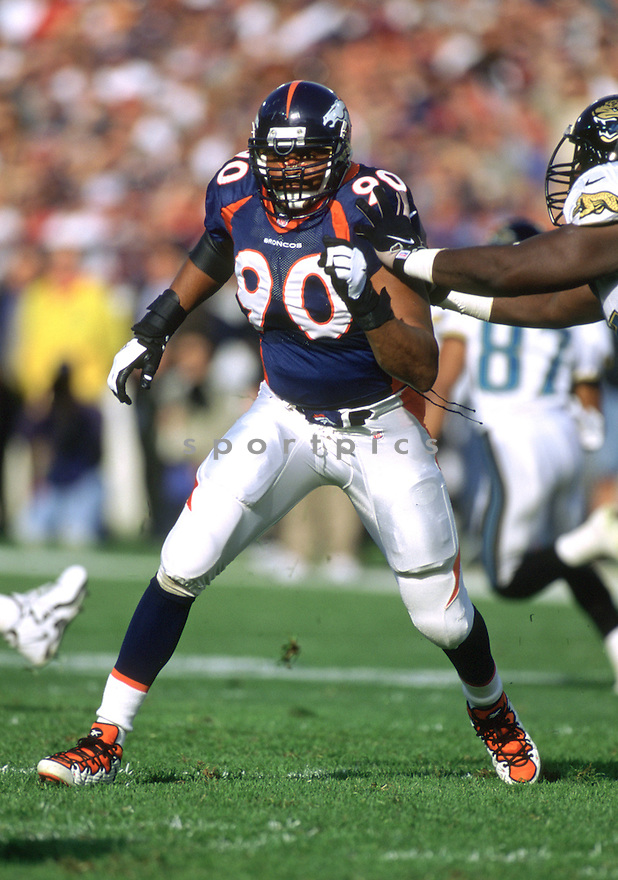 Denver Broncos Neil Smith (77) during a game from his 1998 season with the Broncos. Neil Smithplayed for 13 years with 3 different teams and  was a 6-time Pro Bowler.