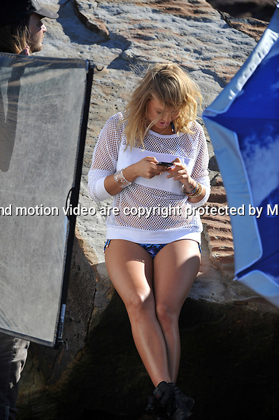 24 AUGUST 2013 SYDNEY AUSTRALIA<br /> <br /> EXCLUSIVE PICTURES<br /> <br /> Lara Bingle pictured posing in different outfits and swimsuits while on location for a photoshoot shot in various locations around Sydney's Northern Beaches. <br /> <br /> *No internet without clearance*.MUST CALL PRIOR TO USE +61 2 9211-1088. Matrix Media Group.Note: All editorial images subject to the following: For editorial use only. Additional clearance required for commercial, wireless, internet or promotional use.Images may not be altered or modified. Matrix Media Group makes no representations or warranties regarding names, trademarks or logos appearing in the images.