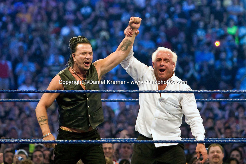Actor Mickey Rourke celebrates with Ric Flair after beating WWE Superstar Chris Jericho during WrestleMania 25 at Reliant Stadium on April 5, 2009 in Houston, Texas.