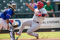 Memphis Redbirds catcher Audry Perez (40) slides home before Round Rock Express catcher Tomas Telis receives the ball during the first game of a Pacific Coast League doubleheader on August 3, 2014 at the Dell Diamond in Round Rock, Texas. The Redbirds defeated the Express 4-0. (Andrew Woolley/Four Seam Images)
