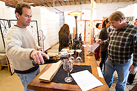 1/2/2011- Kent Callaghan pours wine in the tasting room at Callaghan Vineyards in Sonoita, Arizona. (Photo by Pat Shannahan)