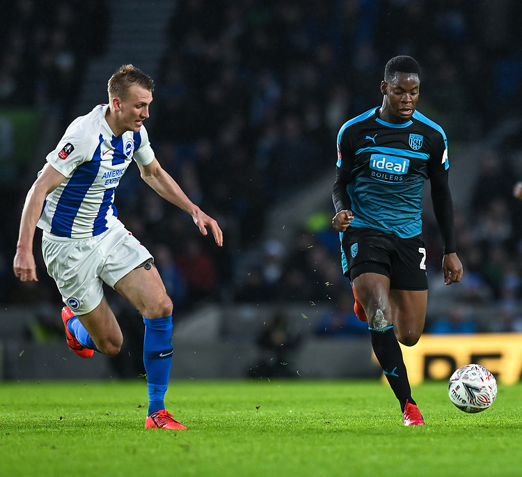 West Bromwich Albion's Jonathan Leko (right) under pressure from Brighton & Hove Albion's Dan Burn (left) <br /> <br /> Photographer David Horton/CameraSport<br /> <br /> Emirates FA Cup Fourth Round - Brighton and Hove Albion v West Bromwich Albion - Saturday 26th January 2019 - The Amex Stadium - Brighton<br />  <br /> World Copyright © 2019 CameraSport. All rights reserved. 43 Linden Ave. Countesthorpe. Leicester. England. LE8 5PG - Tel: +44 (0) 116 277 4147 - admin@camerasport.com - www.camerasport.com