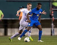 PHILADELPHIA, PA - JUNE 30: Leandro Bacuna #10 dribbles the ball away from Tyler Boyd #21 during a game between Curaçao and USMNT at Lincoln Financial Field on June 30, 2019 in Philadelphia, Pennsylvania.