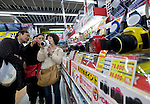 Shoppers from China look at a camera in the Bic Camera electronics store in the Ginza district of Tokyo, Japan on Tuesday 16 Nov. 2010..Photographer: Robert Gilhooly
