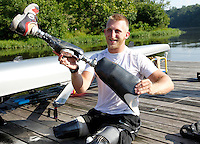Former Marine sergeant Rob Jones jokes around as he prepares to reattach his bionic legs after a rowing workout Wednesday July, 25, 2012 on a dock on the Rivanna River in Charlottesville, VA. Former Marine sergeant Jones, who lost both legs during an IED explosion in Afghanistan, will compete as a rower at the 2012 Paralympics in London, England. Rowing will make its appearance at the London Paralympic Games for only the second time, after its introduction at the Beijing 2008 Games. Photo/Andrew Shurtleff