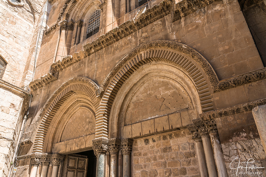 The facade of the Church of the Holy Sepulchre in the Christian Quarter of the Old City of Jerusalem.  The Old City of Jerusalem and its Walls is a UNESCO World Heritage Site.  This church was built over the site believed by many to be location of the death and burial of Jesus Christ.