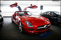 BNPS.,co.uk (01202 558833)<br /> Pic: SilverstoneAuctions/BNPS<br /> <br /> 2010 SLS AMG gullwing sold for £203,000 moments later...<br /> <br /> British collecter in Million pound double swoop on two super rare 'Gullwing' Mercedes at classic car auction.<br /> <br /> Two distinctive Mercedes 'Gullwing' cars have sold for over £1m - to the same buyer.<br /> <br /> One of the motors was a classic 1954 coupe, the Mercedes SL300 Gullwing, that went under the hammer for a whopping £832,000.<br /> <br /> The other, a modern 2010 Mercedes SLS AMG which had done only 690 miles, fetched over £203,000.<br /> <br /> The Mercedes SL300 Gullwing was an instant hit on its release thanks in part to its iconic lifting doors.<br /> <br /> Around 1,400 Gullwings were made between 1954 and 1963, the vast majority of which were exported to the US.