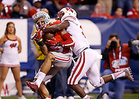 Ohio State Buckeyes wide receiver Devin Smith (9) catches a 44-yard touchdown pass behind Wisconsin Badgers cornerback Derrick Tindal (25) during the second quarter of the Big Ten Championship game at Lucas Oil Stadium in Indianapolis on Dec. 6, 2014. (Adam Cairns / The Columbus Dispatch)