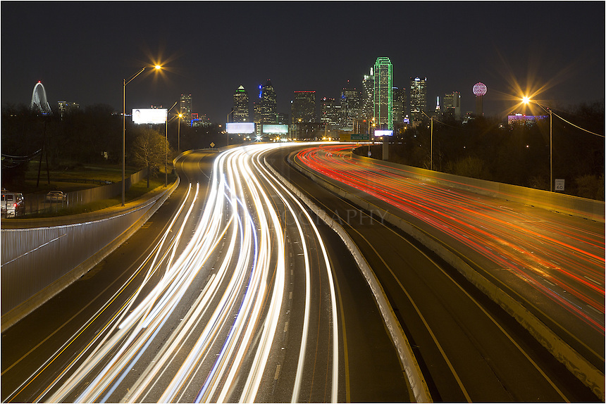 Standing on an overpass in Oak Cliff on the east side of Dallas isn't my idea of a fun evening, but when you can find locations like this for capturing a Dallas skyline image, I'll do it. I make sure I bring a buddy, or in this case, my dad. We made quick work, parking, running to the overpass, taking some long exposures, then running back to the car where we felt a little more safe. ..This is one of the Dallas cityscape images I escaped with, and the skyline is beautiful at night. Reunion Tower is on the right, the Bank of America Plaza (the green building) is in the middle, and on the far left you can see the new Trinity River Bridge (also called the Margaret Hunt Hill Bridge).