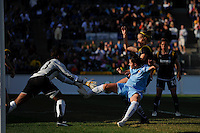 Sarah Walsh (8) of Sky Blue FC takes a shot while defended by Allison Falk (3) and goalkeeper Karina LeBlanc (23) of the Los Angeles Sol. The Los Angeles Sol defeated Sky Blue FC 2-0 during a Women's Professional Soccer match at TD Bank Ballpark in Bridgewater, NJ, on April 5, 2009. Photo by Howard C. Smith/isiphotos.com