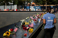 NEW YORK, NY - SEPTEMBER 11: Hundreds of people leave flowers during the September 11 commemoration ceremony at the 9/11 Memorial at the World Trade Center. On September 11, 2019, in New York. Throughout the country there were changes to remember the 2,977 people who were killed. (Photo by Pablo Monsalve / VIEWpress)