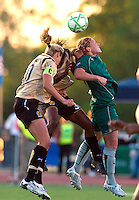 St Louis Athletica midfielder Lori Chalupny (17) goes up for a header against FC Gold Pride midfielder Leslie Osborne (10) during a WPS match at Korte Stadium, in Edwardsville, IL, May 9 2009. Athletica won the match 1-0.