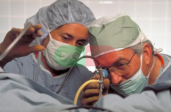 surgeon performs surgery using scope, endoscopy