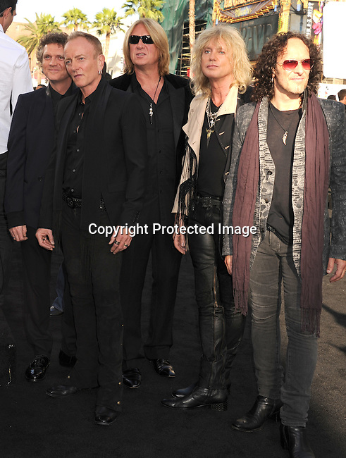 HOLLYWOOD, CA - JUNE 08: Vivian Campbell, Phil Collen, Rick Allen, Rick Savage and Joe Elliott of Def Leppard arrive at the 'Rock Of Ages' - Los Angeles Premiere at Grauman's Chinese Theatre on June 8, 2012 in Hollywood, California.