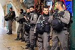 Israeli policemen stand guard at street in Jerusalem's old city on Dec. 31, 2015. The Commission of Prisoners' Affairs (CPA) said that at least 6,830 Palestinians were detained by Israeli troops in the occupied Palestinian Territory since the beginning of the year 2015, marking the highest rate of daily arrests in five years, and 3285 Palestinians were detained in the past three months alone since the beginning of violent unrest in early October. Photo by Mahfouz Abu Turk