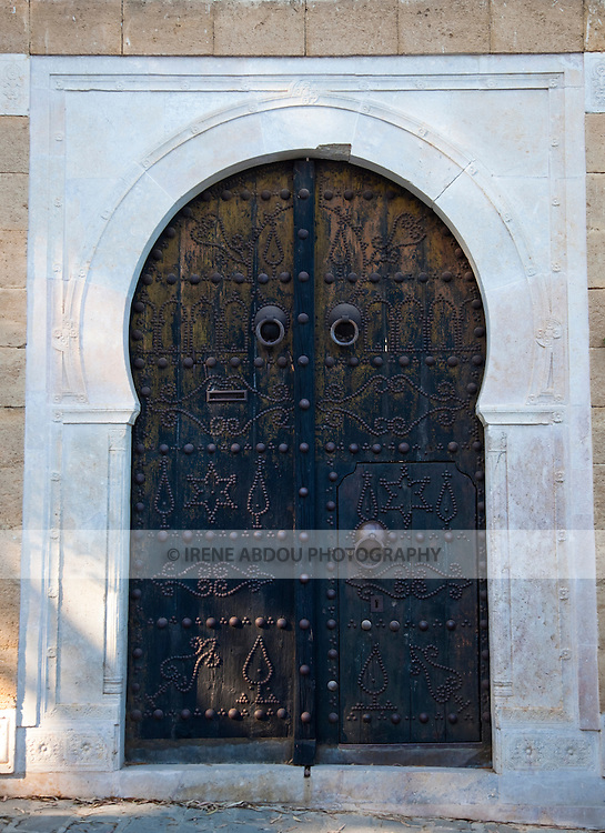 Sidi Bou Said, a town a few kilometers from the legendary city of Carthage, Tunisia, is dotted with traditional wood doors.