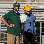Manogue Coach Ernie Howren talks with Josh Rolling before their game played at McQueen High School on Friday, September 1, 2017.