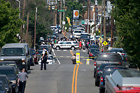 Scene from the bridge on Route 1 looking down the street with the police blockade during come scene activity after a gumnan opened fire on members of Congress who were practicing for the annual Congressional baseball game in Alexandria, Virginia on Wednesday, June 14, 2017. Photo Credit: Ron Sachs/CNP/AdMedia