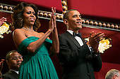 United States President Barack Obama and First Lady Michelle Obama attend the 2013 Kennedy Center Honors on December 8, 2013 in Washington, DC. The honorees this year include: opera singer Martina Arroyo, jazz musician Herbie Hancock, musician Billy Joel, actress Shirley MacLaine and musician Carlos Santana.<br /> Credit: Kristoffer Tripplaar  / Pool via CNP