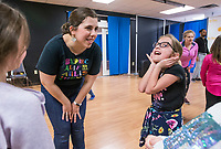 NWA Democrat-Gazette/BEN GOFF @NWABENGOFF<br /> Rachel Bland, Wingate Teaching Artist, works with Bridget Davis, 8, of Bella Vista and other students on a choreography exercise Tuesday, March 19, 2019, during the 'Broadway in Bentonville' spring break day camp at Trike Theatre in Bentonville. Kindergarten through 6th grade students develop their acting, singing and dancing skills studying a popular Broadway musical each day of the camp.