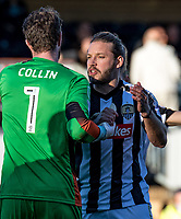 Goalkeeper Adam Collin of Notts County and Alan Smith of Notts County at the final whistle during the Sky Bet League 2 match between Wycombe Wanderers and Notts County at Adams Park, High Wycombe, England on the 25th March 2017. Photo by Liam McAvoy.