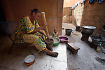 Displaced by war from her home in Timbuktu, Jidata Oyahit prepares food in a shared house in Bamako, Mali. Thousands of families displaced by the fighting in northern Mali have taken refuge in the capital and other areas of the country's south, most living with relatives or renting small spaces. Many have received support from the ACT Alliance.