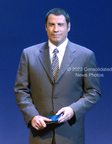 """Chantilly, VA - December 11, 2003 -- Actor John Travolta introduces a slide show and aviation pioneers as part of the """"Legacy of Flight"""" during the dedication of the Steven F. Udvar-Hazy Center  of the National Air and Space Museum in Chantilly, Virginia on December 11, 2003.  Travolta is an accomplished jet flyer and owns and pilots a Boeing 707 jetliner..Credit: Ron Sachs / CNP.(RESTRICTION: NO New York or New Jersey Newspapers or newspapers within a 75 mile radius of New York City)"""