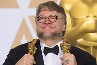 Guillermo del Toro  pose backstage with the Oscar&reg; for best motion picture for work on &ldquo;The Shape of Water&rdquo; during the live ABC Telecast of The 90th Oscars&reg; at the Dolby&reg; Theatre in Hollywood, CA on Sunday, March 4, 2018.<br /> *Editorial Use Only*<br /> CAP/PLF/AMPAS<br /> Supplied by Capital Pictures