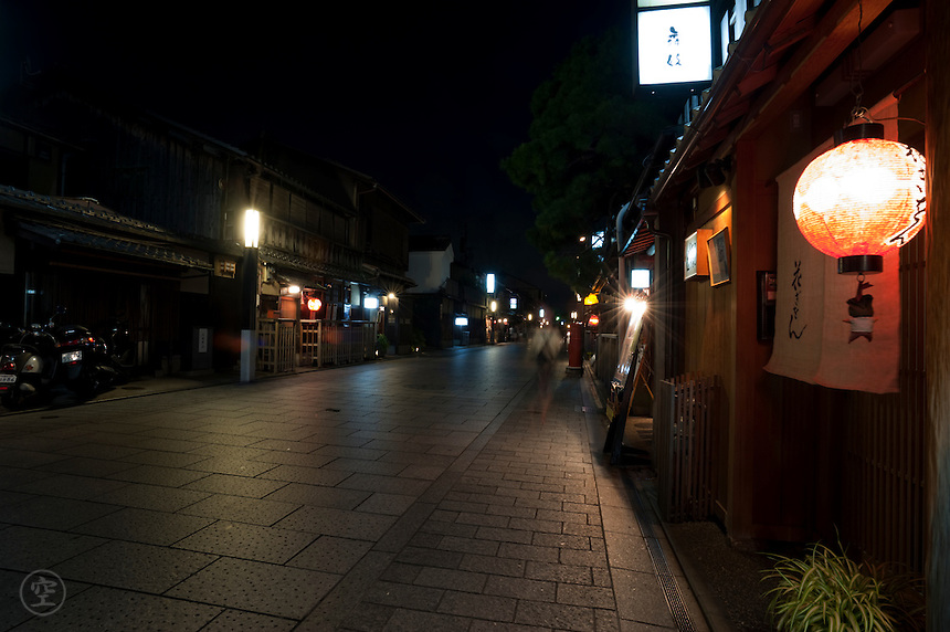 The streets of Gion, one of Kyoto's most famous hanamachi or pleasure districts, on a summer night.