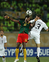 The United States' Dillon Powers fights for a header against Cameroon's Adolphe Teikeu (12) during the FIFA Under 20 World Cup Group C Match between the United States and Cameroon at the Mubarak Stadium on September 29, 2009 in Suez, Egypt.