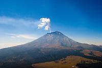 Mexico city's volcanoes popocatepetl  and iztlazihuatl, shrowded by smog