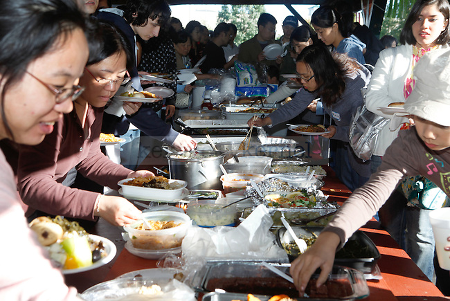 Many people partake in the traditional chinese dinner that was put on during the   Moon Festival Celebration at Shillito Park on Saturday, October 3, 2009. Photo by Zach Brake | Staff