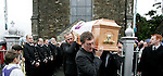 the remains of Martin Dawe Area Officer for the Irish Coast Guard Clogherhead unit being taken from the church with a Guard of Honour from the Irish Coast Guard Units from Clogherhead, Drogheda, Greenore, Skerries, Howth and all over the west Coast. Martin 44 was laid to rest with full honours by the Irish Coast Guard including a fly by the Irish Coast Guard Helicopter from Dublin...As the funeral came to an end the Drogheda Coast Guard unit  as Wellas the Irish Coast Guard Helicopter was call to an emergency on the Beach in Bettystown beach. A car with a mother and two children was floating off the beach as the oncoming tide had sourouned it and as the tide came in swamped the car, one boat from Drogheda was dispatched as well as the helicopter the winch man from the helicopter managed to free the occupants of the vehicle..Photo: Newsfile/Fran Caffrey.