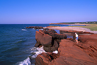 Ile de Grande-Entrée, Iles de la Madeleine, Quebec, Canada - Model Released Woman walking on Rocky Coastline at Bassin aux Huitres along Gulf of St. Lawrence - (Oyster Basin, Grand Entry Island, Magdalen Islands)