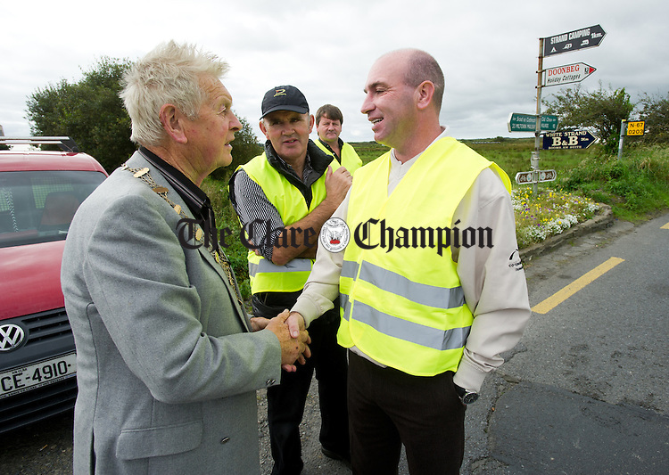 Mayor of Doonbeg Padraig Haugh meets Kilkenny hurling legend DJ Carey during the Declan Hayes Memorial Doonbeg Half Marathon/10K Fun Run and Walk. Photograph by John Kelly.